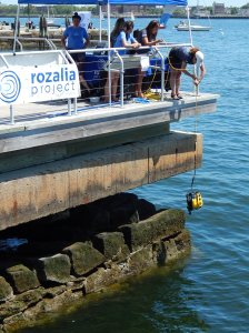 Lowering the ROV into Boston Harbor so that people could see what lies on the floor of the bay.